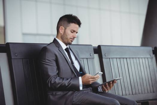 Businessman using digital tablet and mobile phone #411775