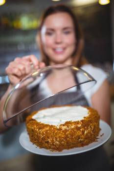 Waitress holding a plate of cake #411779