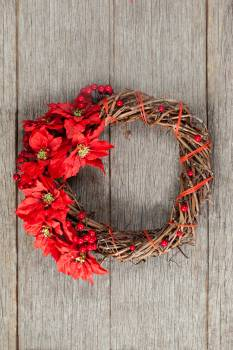 Grapevine wreath on a plank #411801