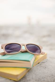 Sunglasses and books on sand  #411813