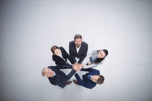 Businesspeople stacking hands together Free Photo