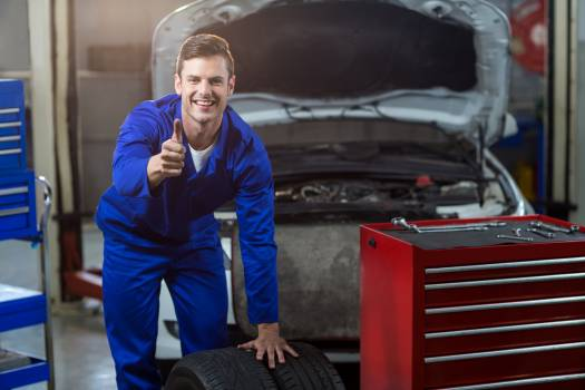 Portrait of mechanic showing thumbs up #411847