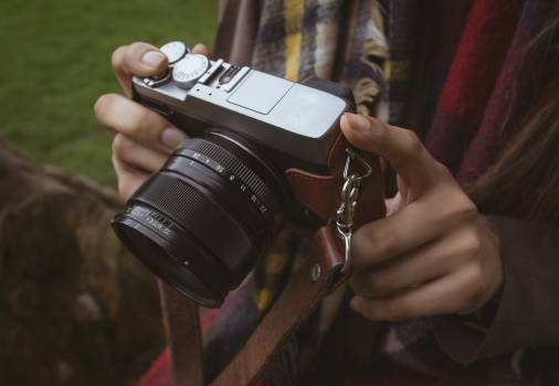 Mid section of woman holding digital camera #411887
