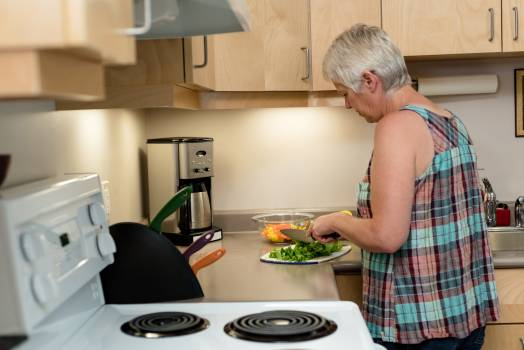 Senior woman cutting vegetable in the kitchen #412025