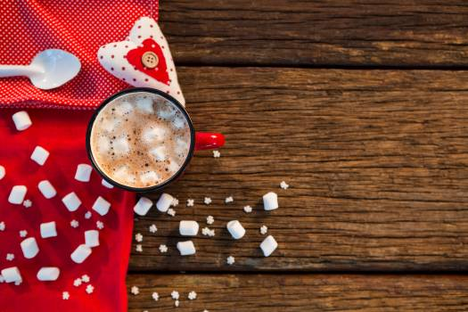 Coffee with sugar cube, napkin and heart on wooden plank Free Photo