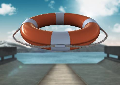 Lifebuoy with rope in mid-air on a sunny day #412040