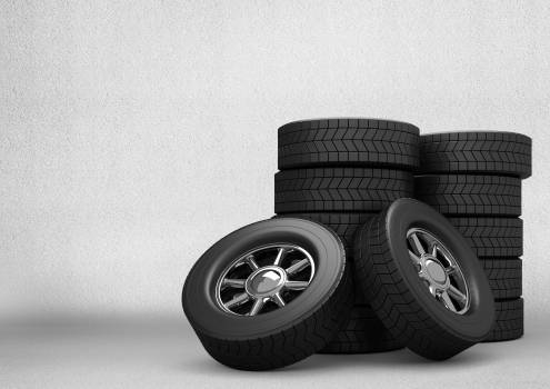 Stack of tyres against grey background #412066