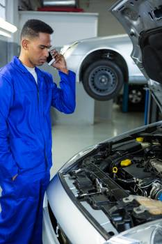 Mechanic talking on a mobile phone #412085
