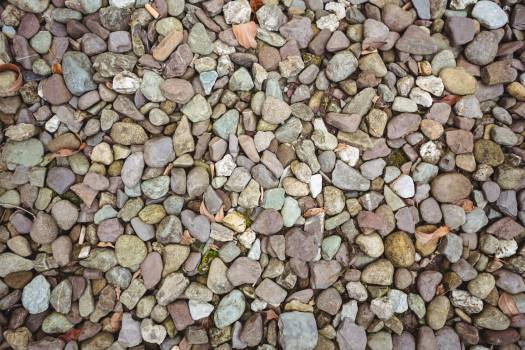 Close-up of gravel background #412126