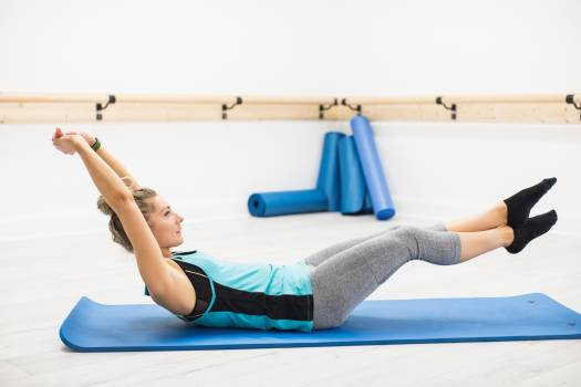Woman performing stretching exercise #412131