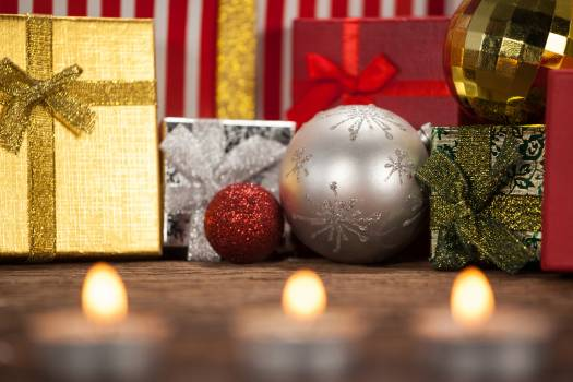 Wrapped gift box and baubles on wooden table #412176