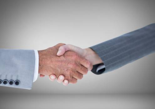 Handshake of Business people against grey background #412181