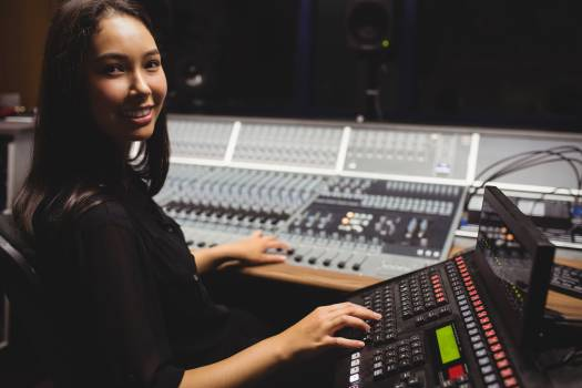 Female student using sound mixer keyboard #412182