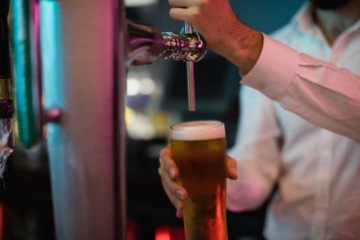 Bartender filling beer from bar pump #412190