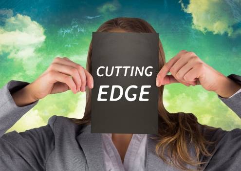 Businesswoman holding a card with cutting edge text Free Photo