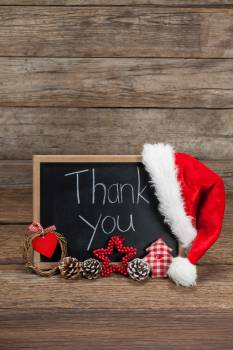 Thank you message on slate with chirstmas decorations on wooden table Free Photo