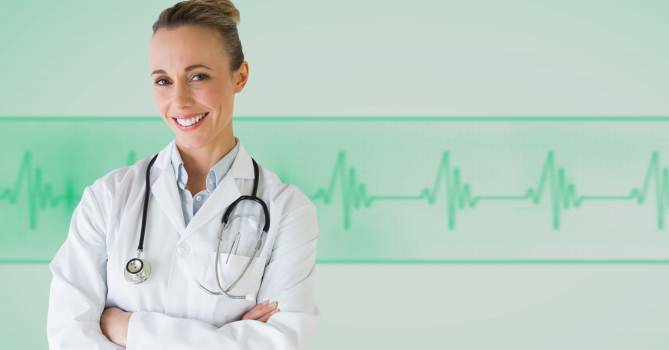 Female doctor standing with her arms crossed against medical background #412245