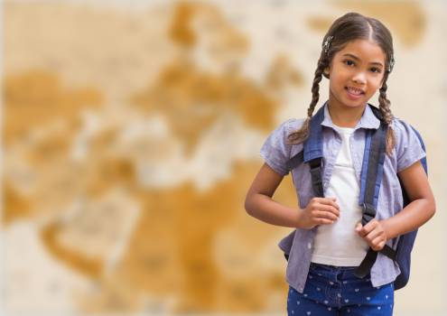 Girl with schoolbag against blurry brown map #412264