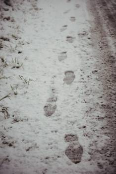 Footprints in snowy road #412268
