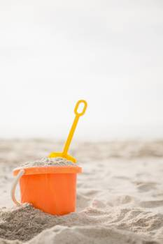 Bucket with sand and a spade on beach #412281