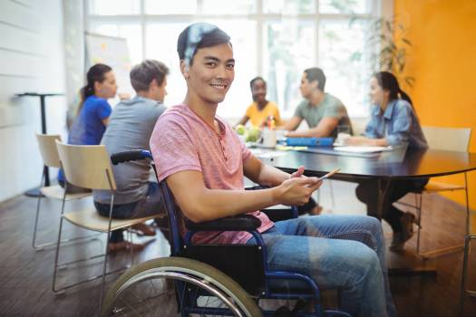 Handicapped business executive using digital tablet #412284