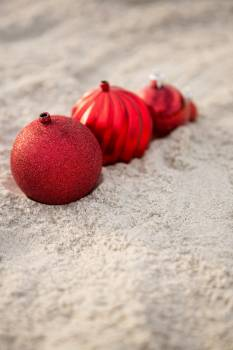 Christmas baubles arranged on the sand #412298
