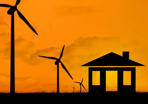 Silhouette wind turbine and house model at dusk Free Photo