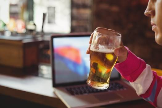 Man holding a glass of beer #412336