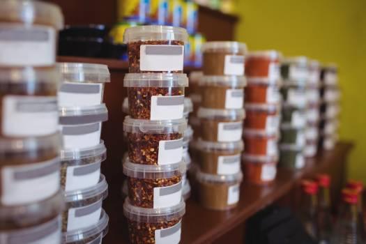 Close-up of various spice jars arranged on shelf #412345