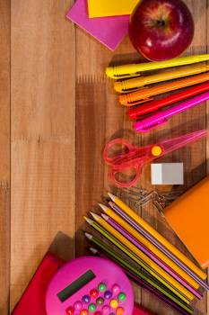 School essentials on wooden table #412347