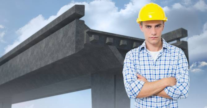 Male engineer standing with arms crossed against under construction bridge #412367