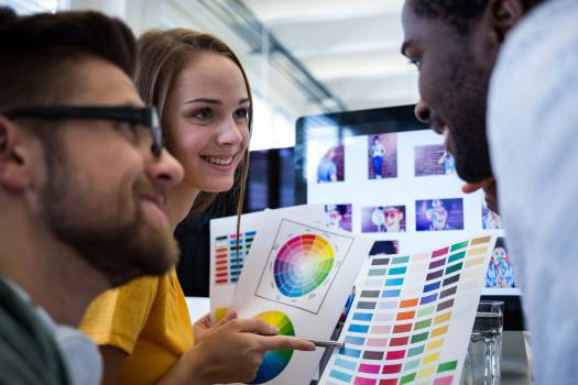 Group of graphic designers choosing color from a color chart #412398