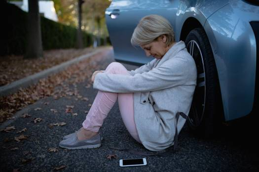 Worried woman sitting beside the car #412431