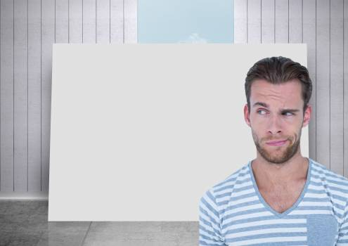Man thinking against blank card in room and sky background Free Photo