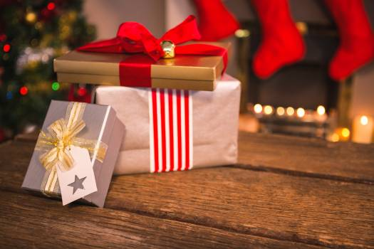 Wrapped gifts on wooden table Free Photo