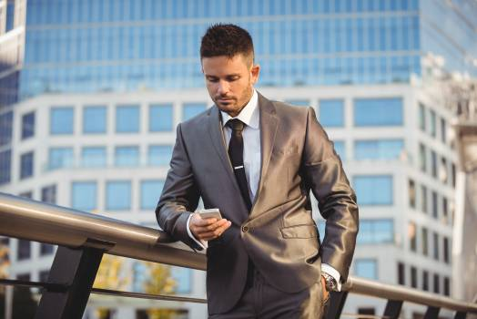 Businessman using mobile phone Free Photo