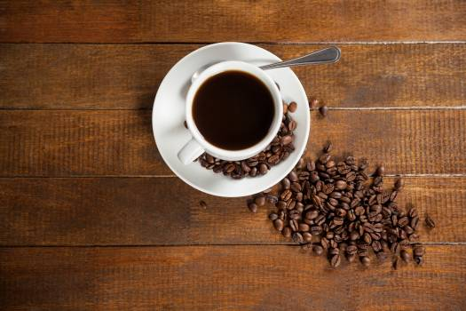 Cup of coffee with coffee beans and spoon #412476