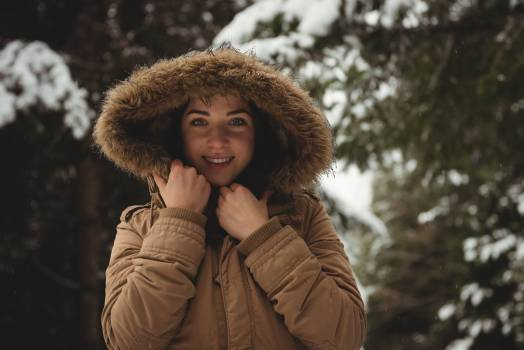 Smiling woman in fur jacket during winter #412482