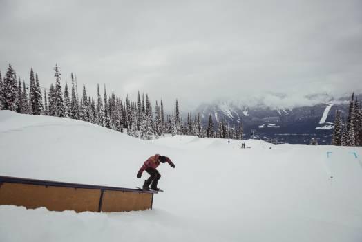 Man skiing on snowy alps in ski resort #412502