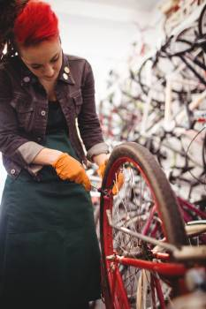 Mechanic repairing a bicycle wheel #412523