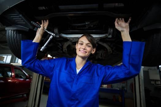 Female mechanic servicing a car #412531