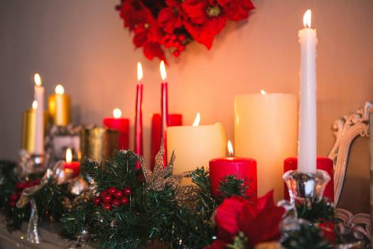 Candles and christmas decorations arranged on fireplace #412555