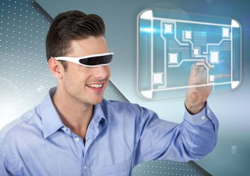 Man using virtual reality headset and touching a digital screen #412558