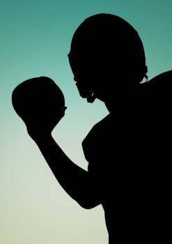 Silhouette of athlete holding rugby ball #412587