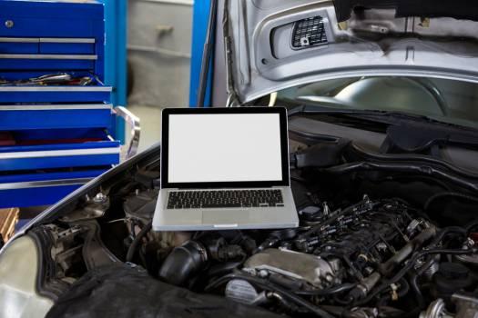 Laptop on car bonnet #412594