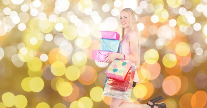 Woman with shopping bags and gifts over bokeh #412603