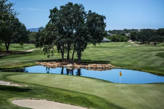 Golf Terrain Near Body of Water Free Photo
