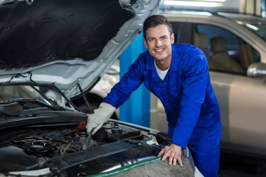 Mechanic servicing a car engine #412644