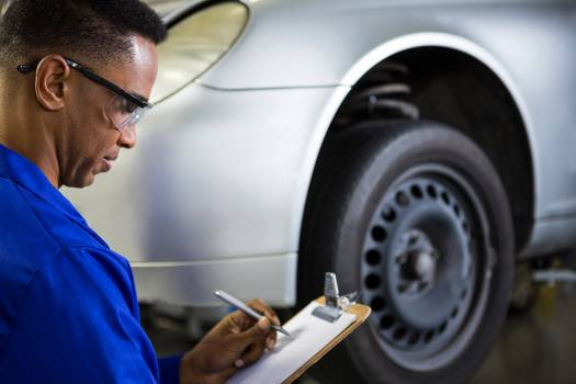 Mechanic preparing a check list #412661