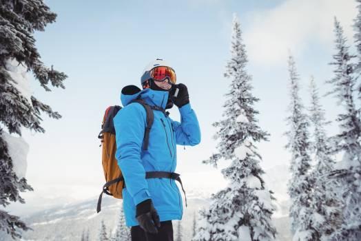 Skier talking on mobile phone #412664